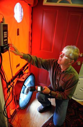 Flemming Lund performing a blower door test in Concord, MA.