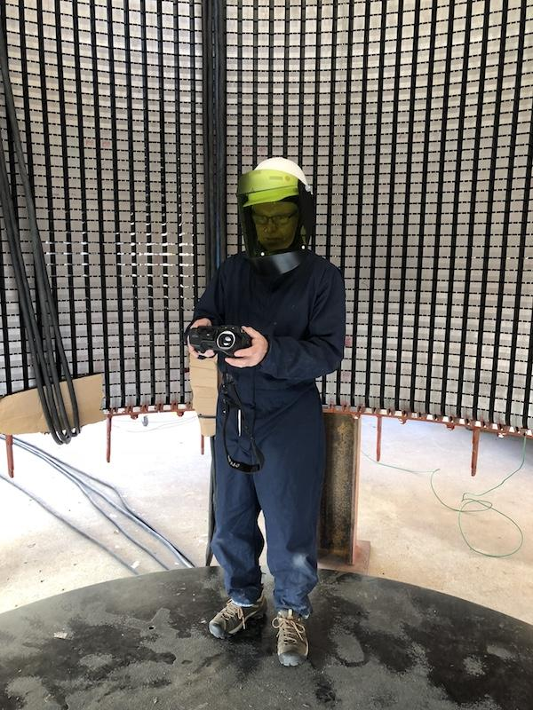 Image of Flemming Lund in an Arc Flash Protection Suit while performing a infrared Draft Core Loop inspection for a Massachusetts business owner.
